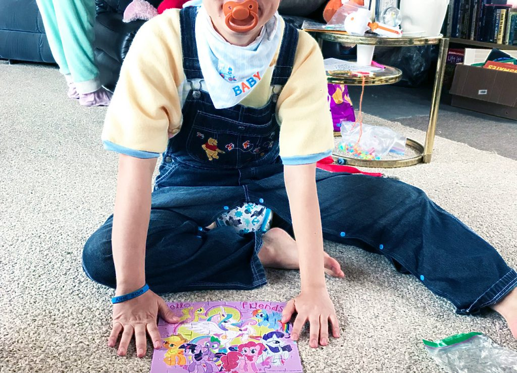 ABDL Boy doing puzzle on floor