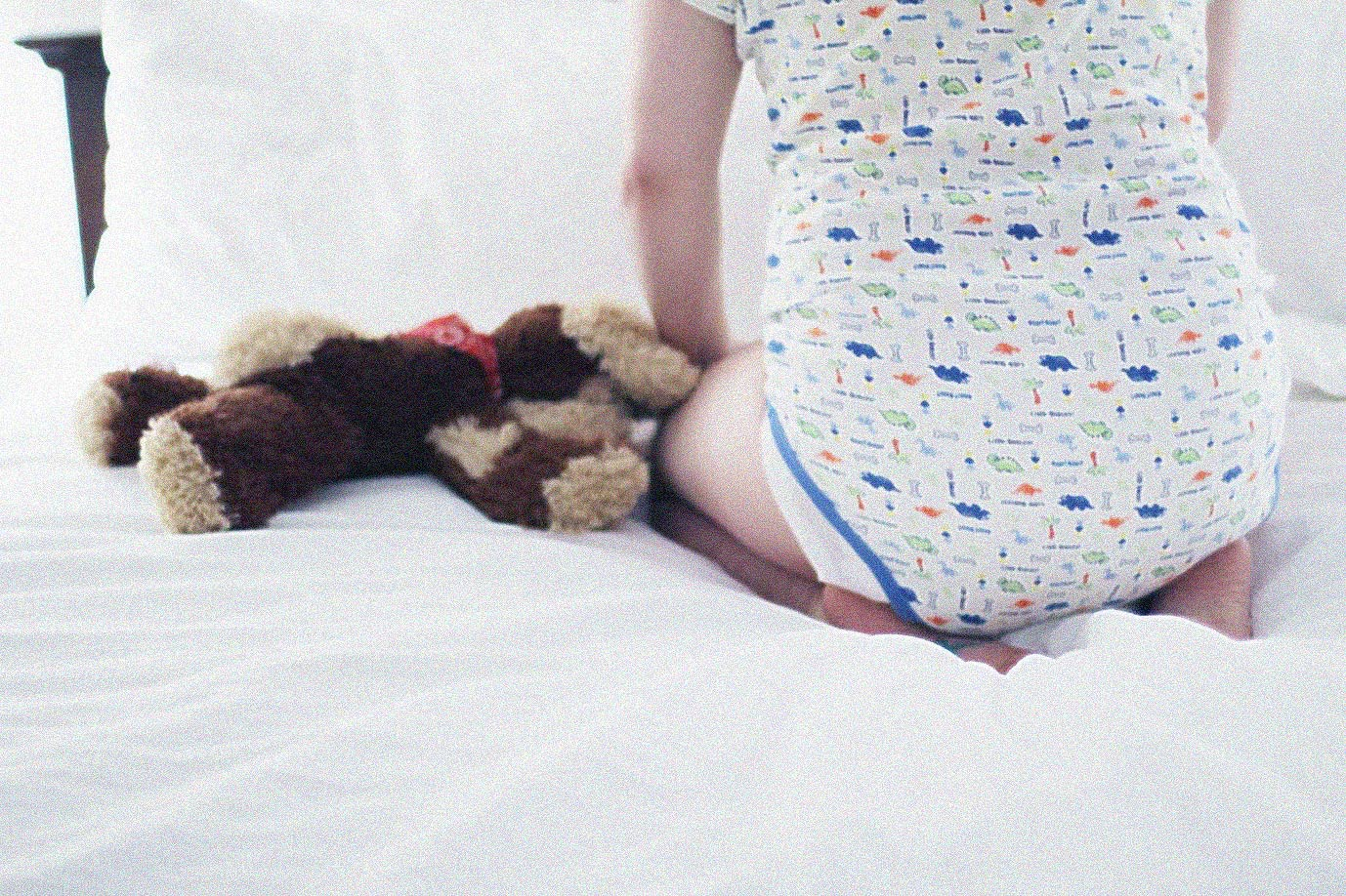 abdl boy in bed with plushy